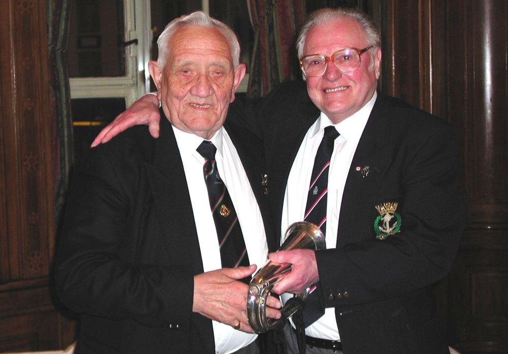 Sam McKnight receives the 'bugle' from Jack Murphy